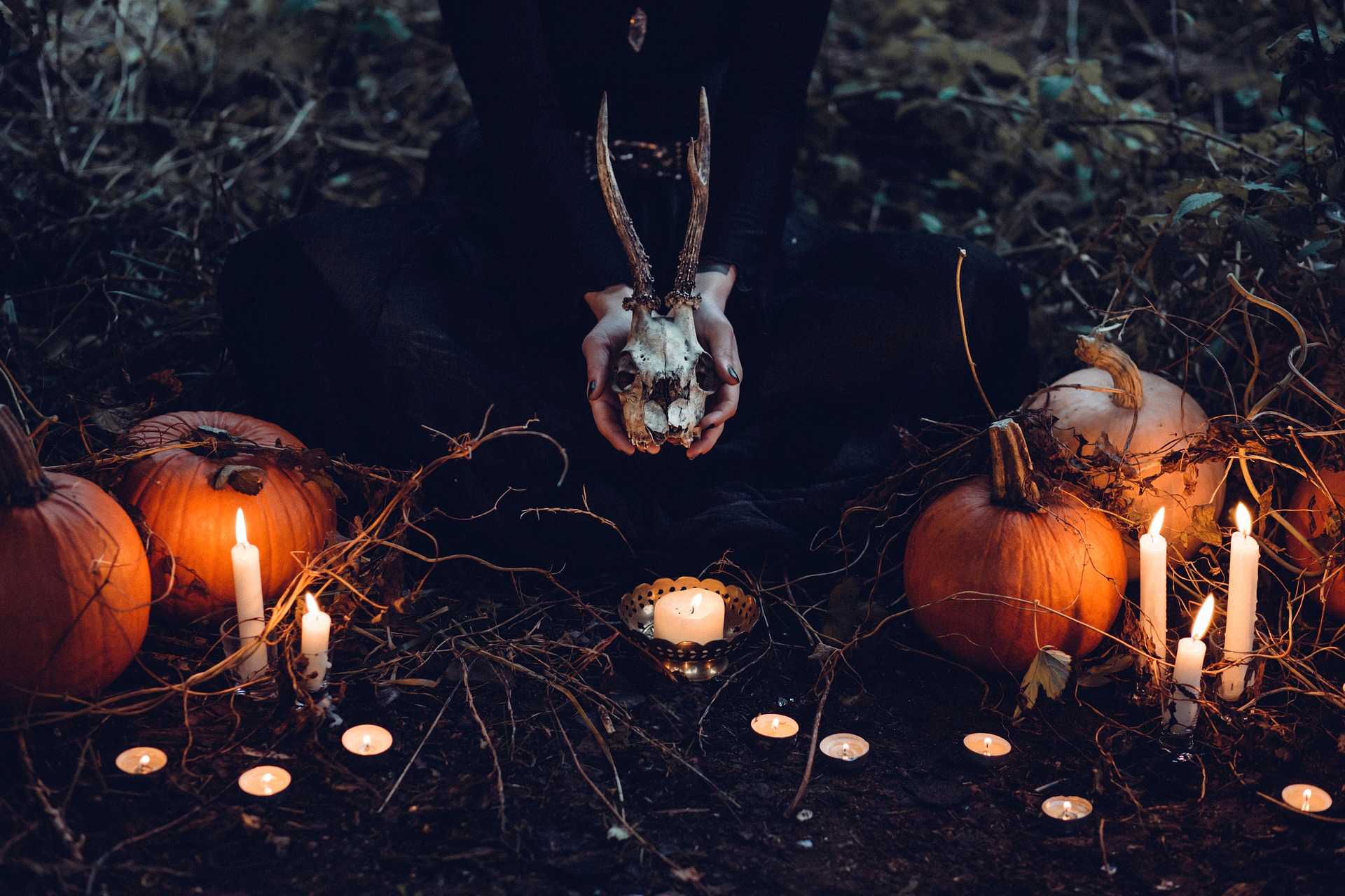 witch performing sacrifice on halloween