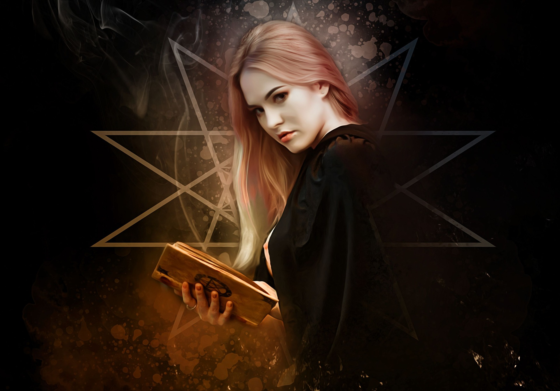 witch holding book in hand performing magic